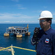 Employee standing near an offshore platform in East Kalimantan
